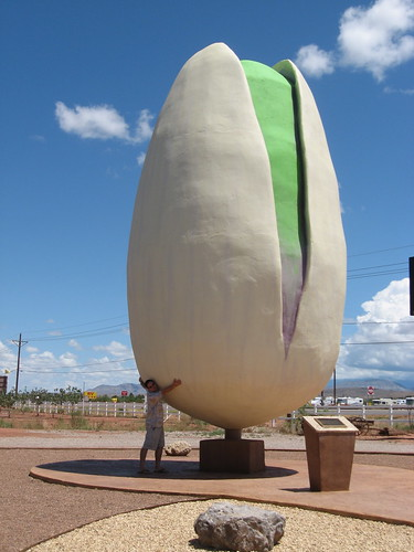 Jason hugging a giant pistachio, cause he is a dork.