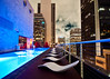 all of the lights. (red.dahlia) Tags: red pool night losangeles couple cityscape thestandard aonbuilding loungechairs kanyewest rooftopbar insilhouette 1232am onewilshirebuilding allofthelights figueroaatwilshirebuildingreflection