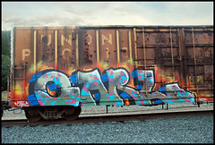 Carl (huntingtherare) Tags: train graffiti border unionpacific hotcarl nr freight babyridged skycomposite