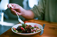 Beet Salad (La Branaro) Tags: food film austin restaurant salad movement texas fuji dof hand arm bokeh eating superia fork depthoffield 35mmfilm 400 ft shallow superia400 petri beetsalad lacondesa frozenmovement downtownrestaurant