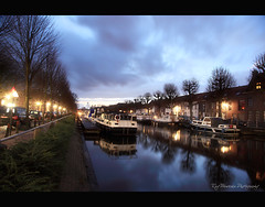 Predikherenrei (pic fix) Tags: morning sky holiday reflection clouds buildings boats dawn lights canal belgium brugge 2010 bruge