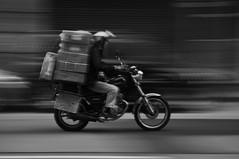 Rush Hour 1 (MayoOnChips) Tags: road blackandwhite man bike speed hongkong slow helmet central tram motorbike rush shutter pan suzuki macau baggage panning causewaybay tramlines urgency