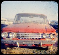 """Scenic byways"" (Maureen Bond) Tags: ca red classic film car automobile desert kodak headlights grill tires bumper chrome scanned americana rambler developed 1962 coolride ttv maureenbond hollywoodrentals popcamcamera"