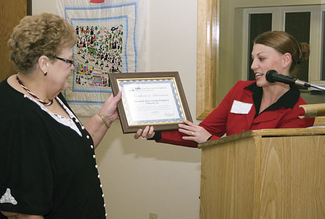 Kelly Edwards, (right) representing USDA Rural Development presents HAVEN, Inc. Executive Director, Judy Woller, with a Certificate acknowledging the efforts of the community and surrounding county.