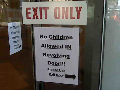 Sign on revolving door