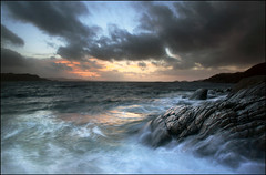 Dark & Stormy - Loch Nan Uamh (angus clyne) Tags: ocean blue winter sunset shadow red sea wild cloud sun seascape storm west reflection beach water rain rock stone night canon dark point landscape gold islands coast scotland boat fishing europe long exposure shine angle wind angus dusk south north wide salt rocky scottish windy ground stormy down gale spray east explore highland photograph hour sound sail loch setting dri gloaming clyne arisaig lochailort leefilter colorphotoaward lochnanuamh saariysqualitypictures