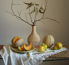 A Piece of Work. (Esther Spektor - Thanks for 10+ millions views..) Tags: lighting light stilllife orange brown white green home apple leaves yellow fruit table golden artwork beige ceramics branch dish artistic lace decorative creative knife dry explore pear vase cloth tablecloth wicker everydaylife cantaloupe naturemorte coth bej silwerware