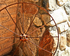 Rusty Wheel [Explore  23 Sep 2016] (studioferullo) Tags: art beauty bright colorful gold brown ochre contrast country old design detail decay farm ranch geometry house light metal stone brick minimalism outdoor outdoors outside pattern pretty rust scene serene study sunlight sunny texture transport wheel round curve line lines tanqueverde tucson arizona abstract