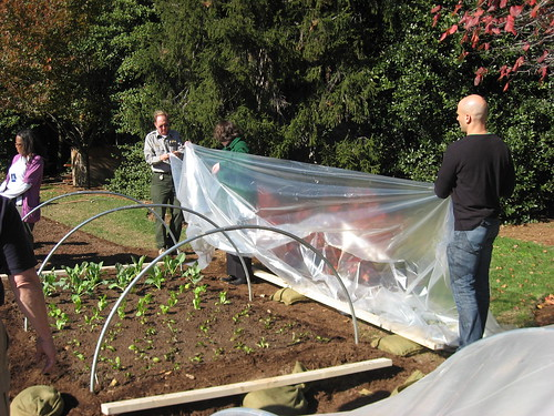 White House Assistant Chef Sam Kass and Agriculture Deputy Secretary Kathleen Merrigan prepare hoop houses at the White House Garden