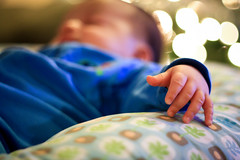 {206/365} (MrsNodders) Tags: sleeping baby 50mm focus hand bokeh christmaslights project365