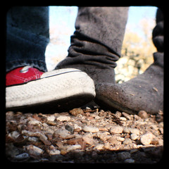 gravel memories (::fotorosso::) Tags: red woman selfportrait feet me girl self vintage square rocks boots pebbles dirty converse dust chucks suede gravel underfoot nomanipulation duaflexii canyoubelieveit ttv throughtheviewfinder kodakduaflex sooc totw 525oftwentyten 525of2010 feelslikehangingwiththedoctorwho itwasachallengetojustleaveitalone fulldisclosureididmakeaminortweakthesaturation