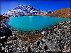 Gokyo Lake (NeilsPhotography) Tags: travel blue nepal panorama lake snow color colour slr wow landscape interestingness amazing interesting rocks asia turquoise pano great explore mountian 2010 outstanding lr3 npl 550d cs5 chhule canon550d neilliddle landseavision liddlephotography