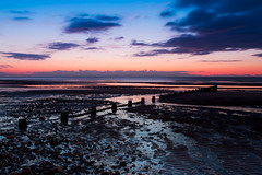 Dying Of The Light (Rossall Beach), Blackpool (flatworldsedge) Tags: wood longexposure blue sunset orange cloud beach silhouette reflections pebbles blackpool breakwater cleveleys fylde thorton rossall explored