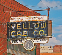 BIG YELLOW TAXI (FotoEdge) Tags: trees usa yellow clouds big downtown neon taxi yellowcab rusty bluesky missouri hanging crusty jonimitchell saintjoseph taxistand stjoe bigyellowtaxi fotoedge bigyellow paveparadise treemuseum bobtravaglione yellowcabcompany
