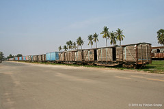 Old freight cars @ Phnom Penh railway station (florian_grupp) Tags: old railroad tree broken grass station train bush cambodia southeastasia rusty railway bluesky terminal dirty palm railwaystation trainstation phnompenh boxcar damaged railways narrowgauge linedup terminus outofservice terminalstation goodswagon freightcar freightwagon metergauge metregauge goodscar cambodiarailways royalcambodiarailways royalrailwaysofcambodia