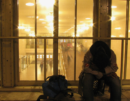 Homeless man sleeping in the rear of Grand Central.