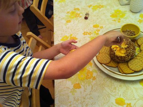 making himself a cheeseball sandwich