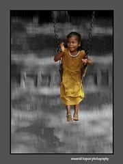 (Anwar Kapasi) Tags: girl lumix swing mumbai panning yello fz50 akapasi