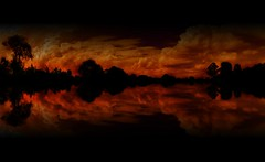 Lake Of Fire (rhyspope) Tags: new morning sunset red sky orange cloud lake storm black reflection tree nature water glass silhouette yellow wales creek sunrise canon river landscape mirror stream afternoon south australia lagoon richmond reflect cumulus nsw thunderstorm aussie convection storms hawkesbury 500d yarramundi rhyspope