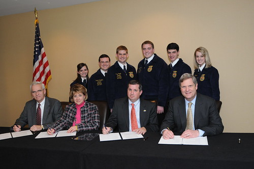 (Left to right) Dwight Armstrong, Melody Alford, Rob Cooper and Agriculture Secretary Tom Vilsack signed a Memorandum of Understanding at the National FFA Foundation Sponsors' Board Meeting on Thursday, January 20, 2011 at the Marriot Metro Center, Washington, D.C.  Behind them are the National FFA Officer Team of (second row, left to right) Shannon L. Norris, Western Region Vice President; Landan Schaffert, Secretary; Riley Pagett, President; Wyatt DeJong, Central Region Vice President; James Flatt, Southern Region Vice President and Tiffany Rogers, Eastern Region Vice President.  (U.S. Department of Agriculture photo by Lance Cheung)