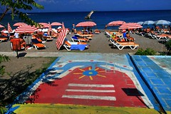 Colourful beach (Marite2007) Tags: blue red summer beach yellow umbrella season relax outdoors islands seaside intense colours chairs vibrant empty scenic vivid greece ornament parasol shores rodos rhodes sunbathing dodecanese sunbeds summercolorful