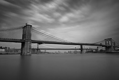 brooklyn bridge. (Vitaliy P.) Tags: street new york city nyc bridge white motion black water glass monochrome brooklyn clouds river moving still nikon long exposure downtown day angle time puppet manhattan welding flag south wide warp cables american daytime gothamist seaport d80 cs5 18135mm shade11 vitaliyp ghettondfilter