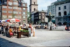 688 - City Mall, Copenhagen ... 6 July 75 (srv007) Tags: people fountain bicycle buildings copenhagen denmark europe scan cobblestone slides 688 eurailpass stonebuildings englandandeurope jasonsavidge rodsavidge