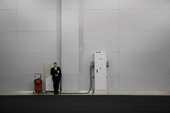 human evolution (Alexandros Kaa) Tags: white man black wall standing hall alone expo transformer space empty hangar guard clean suit simple fireextinguisher