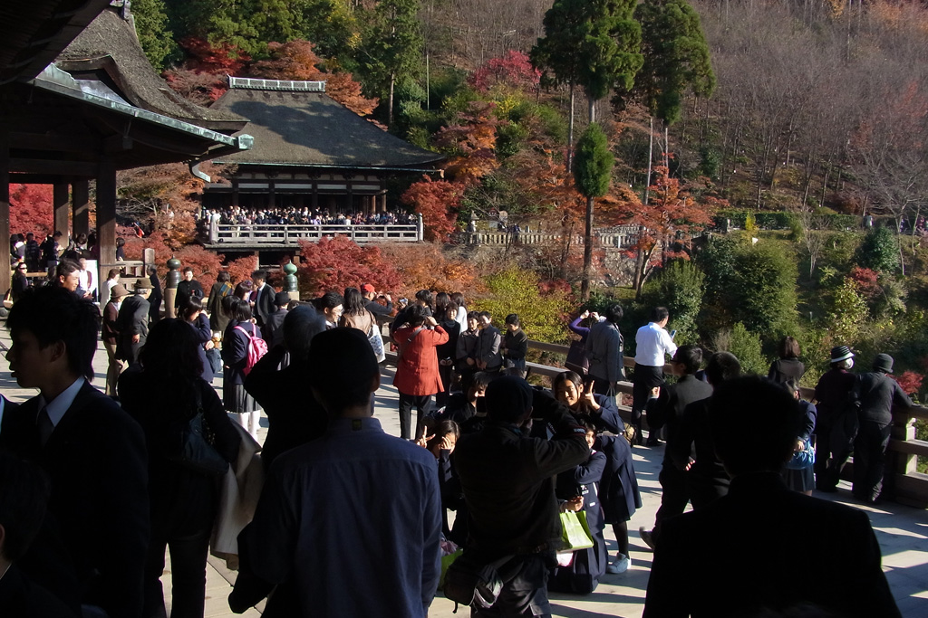 A lot of tourists and students at Kiyomizu-dera main stage