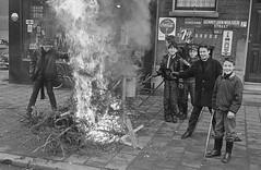 Disposal of Old Christmas Trees (theirhistory) Tags: road christmas street xmas city boy tree shop fire town child pavement coat christmastree burning bonfire jacket wellies
