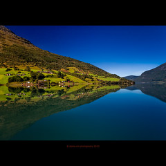 Through the Looking-Glass (stella-mia) Tags: blue sky reflection green norway symmetry explore symmetrical fjord frontpage 2470mm innvikfjorden canon5dmkii symmetricalworld