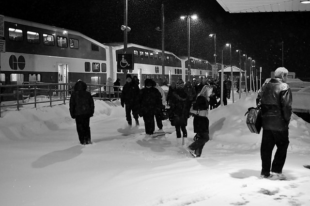 Heading for their cars as first GO Train of the evening arrives at a snowy Barrie South station.