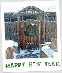 snowy gate with wreath