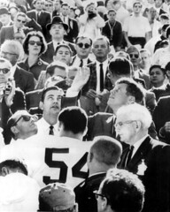 President John F. Kennedy Tossing Coin to Start the Orange Bowl: Miami, Florida (State Library and Archives of Florida) Tags: holland florida miami senator crowd jordan cointoss kennedy johnfkennedy crimsontide orangebowl spessardholland linebacker collegefootball johnkennedy alabamacrimsontide presidentkennedy leeroyjordan statelibraryandarchivesofflorida