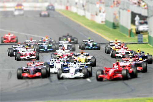 Formula 1 cars leaving the starting line