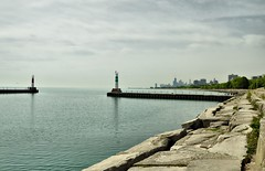 View From Montrose Harbor (Seth Oliver Photographic Art) Tags: chicago reflections illinois nikon midwest lighthouses skyscrapers searstower cityscapes skylines lakemichigan trumptower beautifulclouds montroseharbor pinoy johnhancockbuilding wbez chicagoskyline urbanscapes chicagoist cityskylines d90 northsidechicago wetreflections handheldshot sooc moderncities aperturef90 willistower setholiver1 nd4xfilter springseasoninchicago 0006secondexposure montroseharborlighthouses