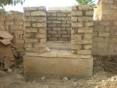 Elevation walls (adobe blocks) (Sustainable sanitation) Tags: construction mud pipe adobe blocks pan vault household slab burkinafaso squatting uddt