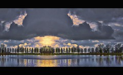 mirror world (Wim Koopman) Tags: trees light sky sun holland reflection water netherlands dutch clouds canon photography mirror photo pond stock powershot mirrored stockphoto s90 stockphotography s100 goudriaan wpk s95