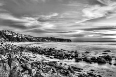 The Strand (Didenze) Tags: longexposure sky bw seascape beach clouds rocks explore danapoint frontpage thestrand hdr bluff canon450d hdrspotting didenze