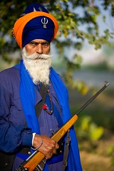 Rosary and the Firearm (gurbir singh brar) Tags: portrait nikon rosary warrior turban sikh nikkor firearm armed khalsa banga nihangs dumala  earthasia  gurbirsinghbrar nihangsingh santsipahi saintsoldier   nikond3s         babaravindersingh