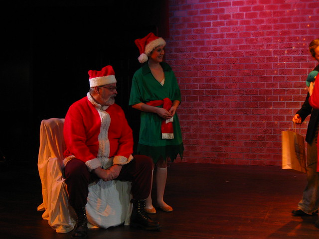 Santa (Douglas Gabrielle) and his Elf (Suzanne Karpinski).