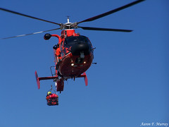 Raising the basket (A. F. Murray) Tags: red sky rescue white america coast fly us basket lift united guard helicopter crew states member