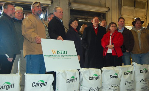 Associate Administrator Janet Nuzum, center, with WISHH executive director Jim Hershey, left of Nuzum, ARREFF president John Fornazor, far left, and soybean producers from Virginia, Illinois and North Carolina with bags of soy flour bound for Afghanistan.