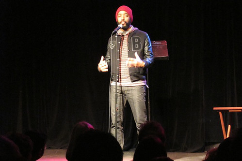 Wyatt Cenac telling a story about spreading Christmas cheer in a prison in Texas
