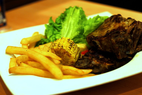 Pan-Fried Pork Chop Cutlet with Grilled Corn, Fries and Apply Sauce