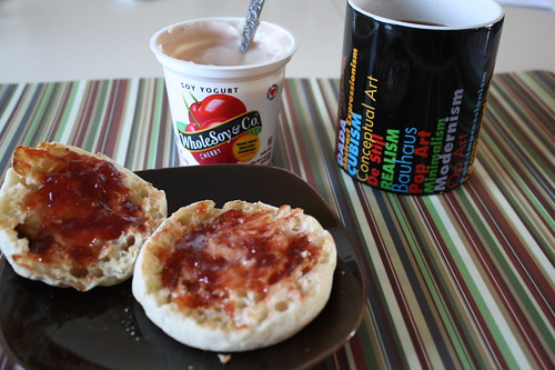 english muffin with strawberry jelly, yogurt, coffee