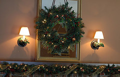 Christmas wreath hung over mirror above fireplace (kizilod2) Tags: christmas pine lights fireplace berries holly wreath evergreen greenery ribbon sconce mantel sconces