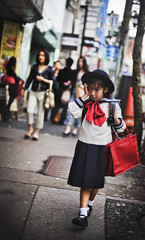 Young Schoolgirl Returning Home in Tokyo (Stuck in Customs) Tags: world city travel school urban building home girl japan skyscraper walking photography tokyo blog high focus uniform asia downtown cityscape child dress dynamic stuck bokeh military young formal s
