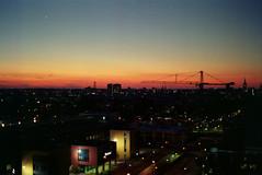 Nice autumnsunset (Kjell_Doggen) Tags: city pink blue sunset sky orange netherlands colors beautiful yellow sunrise lights blauw minolta den nederland hague iso 200 mooi lucht haag geel stad oranje roze x700 kleuren 7200 zonsopkomst plustek zonsondergan opticfilm lichtenvictory