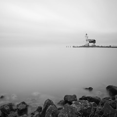White water lighthouse (Dutch Dennis) Tags: longexposure sky bw lighthouse lake holland netherlands monochrome rocks gray nederland surreal filter minimalistic vuurtoren marken waterscape markermeer nd110 paardvanmarken